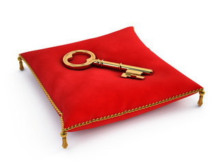 Golden key on red pillow