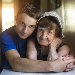 Grandmother and grandson portrait together in an embrace..