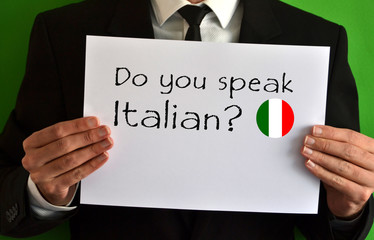 Businessman showing a sheet with text Do you speak Italian