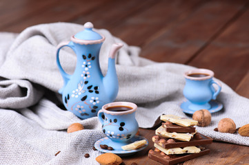 Cookies and chocolate with cup of coffee