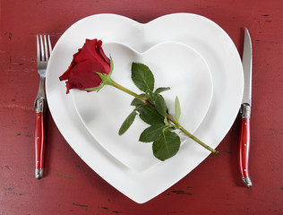 Valentines Day table place setting with red rose