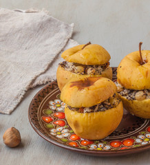 Baked apples with raisin, poppy seeds, rice and honey