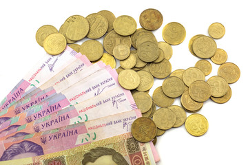 Ukrainian money and pennies on a white background