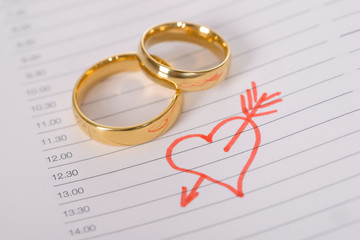 Close-up Of Wedding Rings On Paper