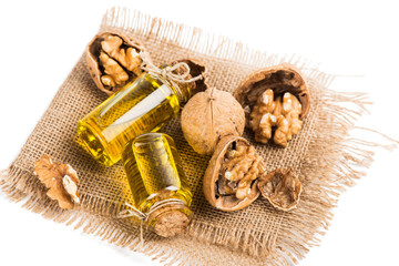 Walnut oil in a small bottles and nuts