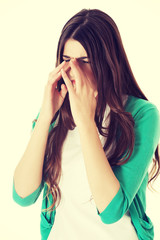 Young woman with sinus pressure.