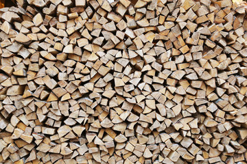 firewood stacked for storage, background