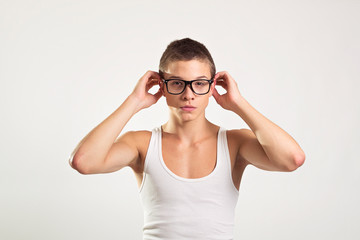 Young male model with eyeglasses and white tank top