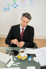 Businessman Taking Medicines