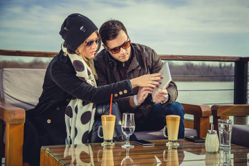 Couple looking at broken tablet