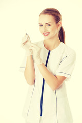Beautiful young nurse or doctor with needle.