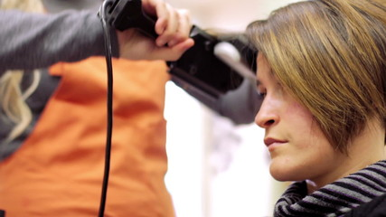 a woman with short hair at the hairdresser - hairdresser - hairstylist