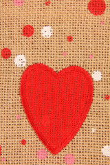 Red heart on canvas