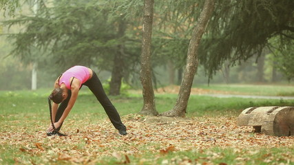 Woman stretching in the park outdoor