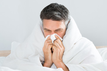 Mature Man Blowing His Nose