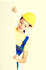 Beautiful worker woman in protective clothes.
