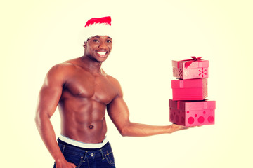 Handsome man in jeans holding presents.