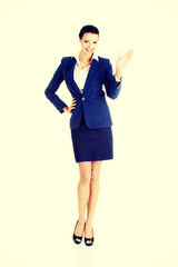 Beautiful business woman waving her hand.