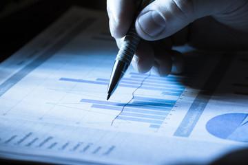 Businessperson Analyzing Graph