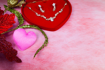 Pink heart-shaped and jewelry in red velvet box