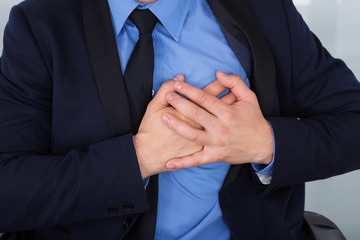 Businessman With Hand On Chest
