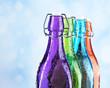 Colorful bottles on light background