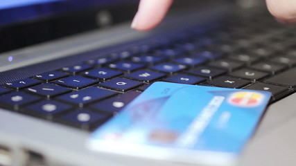 Christmas gifts - Woman holding credit card on laptop for online shopping