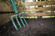 canvas print picture - Garden fork turning compost