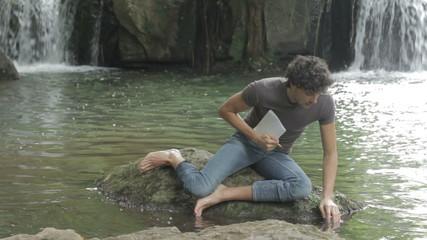 boy are taking  samples of ground of the lake  bottom - terrain -soil