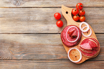 Sliced salami with cherry tomatoes, onion and spices