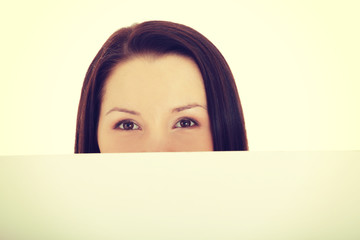 Woman's face behind copy space.