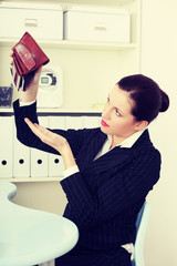 Beautiful business woman with empty wallet.
