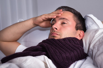Man Suffering From Cold And Fever