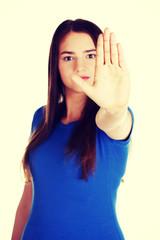 Beautiful woman showing stop gesture.