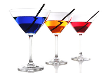 Colorful alcoholic beverages in glasses isolated on white