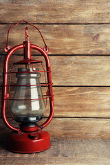 Kerosene lamp on wooden planks background