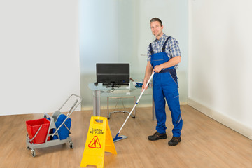Man Cleaning Office Floor