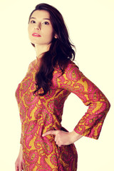 Beautiful woman in colorful dress.