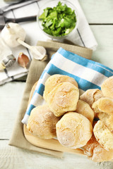Fresh homemade bread buns from yeast dough with fresh garlic