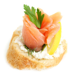 Canape with salmon and herbs isolated on white