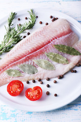 Pangasius fillet with herb and sliced cherry tomatoes