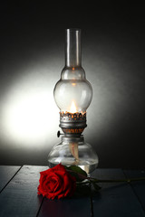 Kerosene lamp with red rose