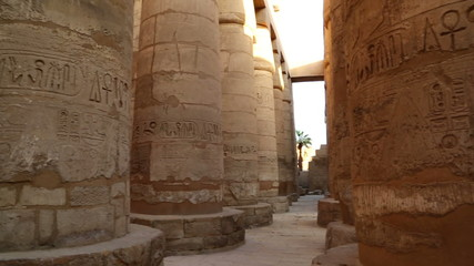 columns in karnak temple with ancient egypt hieroglyphics - pan