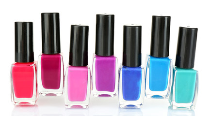 Colorful nail polish isolated on white background