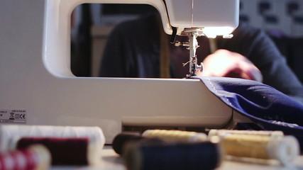 spool of thread - sewing machine -  seamstress