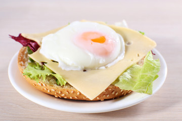 Sandwich with poached egg, cheese and greens
