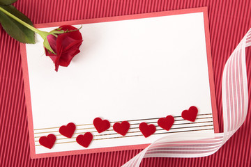 Valentine card with ribbon and rose