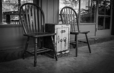 Old Safes. Is between two chairs.