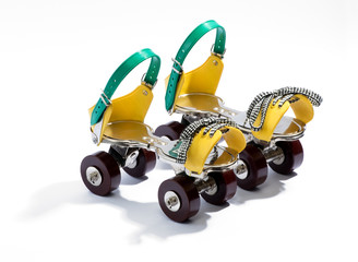 Pair of colorful yellow and blue roller skates