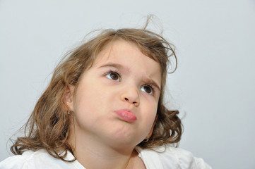 Angry pouting and frowning young girl